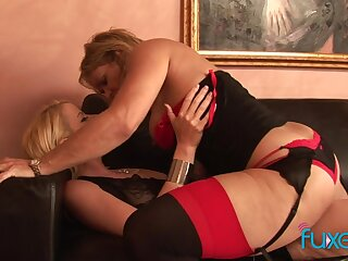 Curvaceous temptress of a MILF fucks a pretty young woman with a strap-on